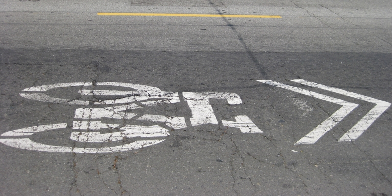 A Sharrow painted on the street. In San Francisco. Sorry everyone. This alt text is my confession that I did not take this photo.