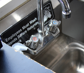 The Mac Genie has a small handwashing sink complete with an'Employees must wash hands before returning to work' sign.