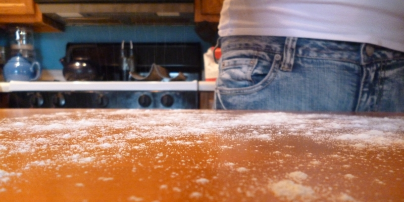 Natalie sprinkles flour over her counter to create a ligtly floured surface for bread kneading