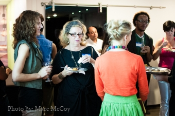 Well dressed people mingle at a Pattern Meet-Up. Photo by Marc McCoy.