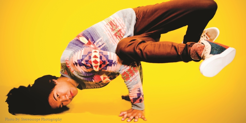 An asian model in a hip-hop headstand wearing a fashionable sweater. Photography by Stereoscope Photography.