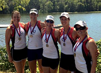Jen Kaido poses with the Masters rowers after an invitational in Michigan.