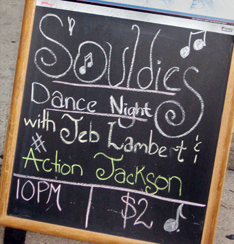 Souldies Night with Jeb Lambert and Action Jackson is written on a sidewalk chalkboard outside Melody Inn.